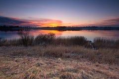 Lake near field after sunset Stock Image