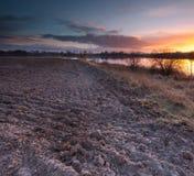 Lake near field after sunset Royalty Free Stock Photo