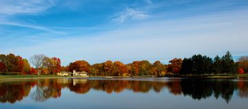 Lake Near Green Trees Under Blue and White Cloudy Sky during Daytime Royalty Free Stock Image