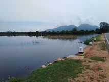 a lake near the road and the lake ended by mountain royalty free stock photography