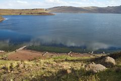 Lake near  Silustani tombs in the peruvian Andes at Puno Peru Royalty Free Stock Photography