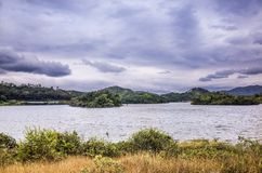 Lake near village Royalty Free Stock Image