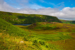 Lake Nestled in the Irish Countryside. The rolling hills between Dublin and the Wicklow Mountains National Park provide a beautiful scene royalty free stock photo