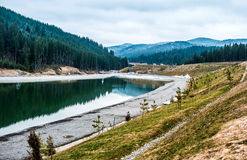 Lake and new relaxation building in Bukovel Royalty Free Stock Images