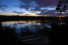 Lake at night. With a boat on the banks Royalty Free Stock Photos
