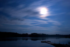Lake night clouds moon landscape. Landscape (night-scape) at the Seliger Lake (Russia) by a summer night. Sky with stars (star trails), the Moon, the forest at Stock Image