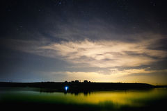 Lake and night sky. Beautiful lake and starry night sky landscape Royalty Free Stock Photo