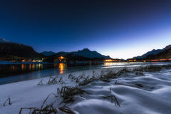 Lake in the night with villages in the background Royalty Free Stock Images
