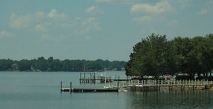 Lake Norman-dock 2. Lake Norman in North Carolina boat dock and ramp and houses on the back shore line Royalty Free Stock Photo