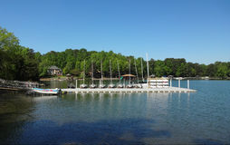 Lake Norman in Huntersville, North Carolina. Boats docked at a pier at Lake Norman in Huntersville, North Carolina with homes in the background royalty free stock photos
