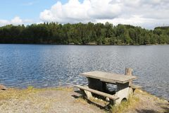 Lake Norsjo, Skien. Lake Norsjo picnic table near Skien. Norway landscape Royalty Free Stock Image