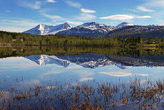 Lake in Norway with snowcapped mountain Stock Images
