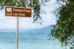 Lake Ohrid signboard, Macedonia. Picture of a Lake Ohrid sign with the lake itself in background Royalty Free Stock Photography