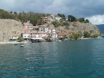 House by house- village on the stone. Lake in Ohrid is very interesting and peaceful place where you can enjoy sounds of waves Stock Photos