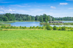 Lake and old castle. Araisi, Latvia, 2015, Nature and mill view. Nature, lake and history buildings Royalty Free Stock Photos