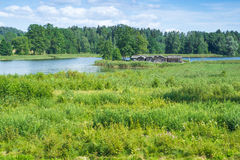 Lake and old castle. Araisi, Latvia, 2015, Nature and mill view. Nature, lake and history buildings Royalty Free Stock Photo