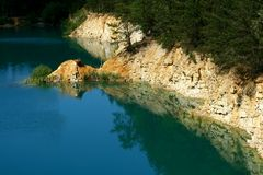 Lake in old open-cast lime mine Stock Image