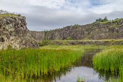 Lake in an Old Stone quarry in Morro do Gaucho mountain landscape royalty free stock photography