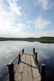 Lake and the old wooden jetty Stock Photos