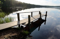 Lake and the old wooden jetty Stock Photo