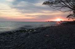 Lake Ontario sunset with sun in the distance Royalty Free Stock Images