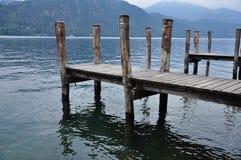 Lake Orta, Italy. Wooden pier Royalty Free Stock Image