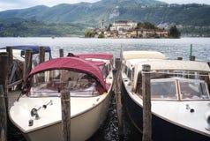 Lake Orta: touristic boats moorage. Color image. Moorage of touristic boats, waiting for client, on the shores of Lake Orta Piedmont, Northern Italy, rainy Stock Photo