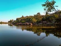 Lake outside Chiang Mai, Northern Thailand. Lake outside Chiang Mai, Thailand. Reflection on the water. Blue sky. Floating burugas stock image