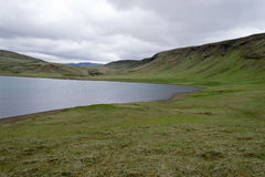 Lake over a mountain. Tundra landscape in Iceland with clouds Stock Images