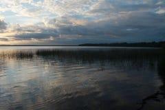 Lake på solnedgången Arkivfoto