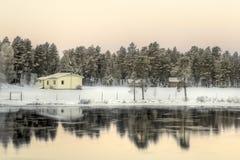 Lake på soluppgången, närliggande Inari, Finland Arkivfoto
