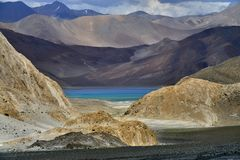 Lake Pangong: among the mountain ranges are light brown and dark in color, like precious stone in the frame, you can see the aquam Stock Photo