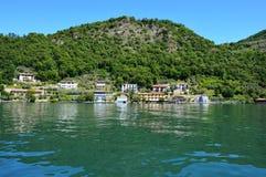 Lake panorama from ferry with island Monte Isola. Italian landscape. Island on lake. Lake Iseo, Italy Stock Photos