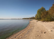 Lake panorama, with fodrest and blue sky. Isolated Stock Photo