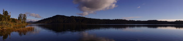 Lake Panorama in New Zealand. A panorama at a beautiful tranquil lake in the South Island of New Zealand Stock Photography