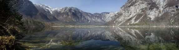 Lake panoramic. Lake and mountains in Slovenia, clear reflective water stock photos