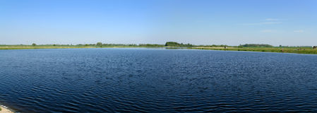 Lake panoramic. A panorama of lake in Lithuania Royalty Free Stock Photography