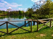 The lake in the park of Agliana. In Tuscany, Italy, surrounded by trees and plants that embellish the photo royalty free stock photography