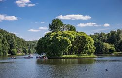 Lake in the park with boats in museum-reserve Tsaritsyno. MOSCOW, RUSSIA - JUNE 16, 2018: Lake in the park with boats in museum-reserve Tsaritsyno royalty free stock image