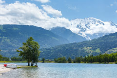 Lake Passy and Mont Blanc mountain massif summer view. Stock Image