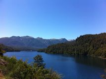 Lake in Patagonia Argentina. Route of the Seven Lakes: from Villa La Angostura to San Martin de los Andes. with forest and blue sky stock photography