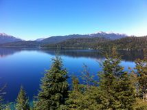 Lake in Patagonia Argentina. Route of the Seven Lakes: from Villa La Angostura to San Martin de los Andes. with forest and blue sky stock photo