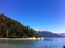 Lake in Patagonia Argentina. Route of the Seven Lakes: from Villa La Angostura to San Martin de los Andes. with forest and blue sky stock image
