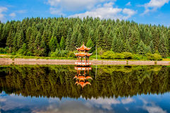 The lake and the Pavilion. We can see the beauty of the lovely man-made lake and the two Chinese pavilions Stock Photography