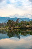 Lake Phewa in Pokhara, Nepal, with the Himalayan mountains in the background, including Machhapuchhre and Annapurna. Stock Image