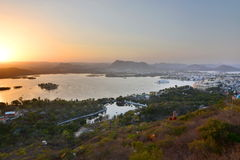 Lake Pichola and Udaipur sunset view. Rajasthan. India Royalty Free Stock Photo