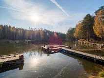 Lake with a berth in the autumn forest royalty free stock photography