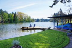 Free Lake Pier With Two Blue Chairs. Royalty Free Stock Images - 25885229