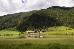Lake Pillersee with farmhouse in Sankt Ulrich am Pillersee, Austria Royalty Free Stock Photo