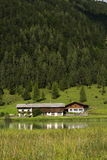 Lake Pillersee with farmhouse in Sankt Ulrich am Pillersee, Austria Stock Photography
